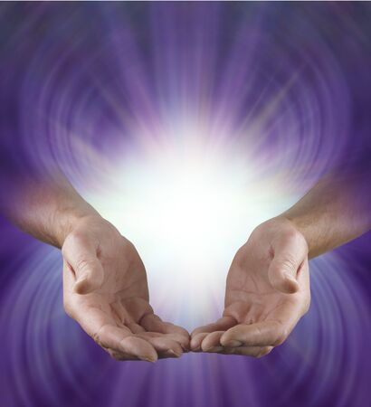 Male Healer Sending Love and Light - male hands in open giving position with shaft of white light above on a deep purple and lilac  radiating background with copy space and bright light