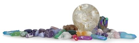 Row of multicoloured Healing Crystals Background Banner - Huge rutilated Crystal Ball surrounded by various tumbled healing stones and terminated quartz with space for copy
