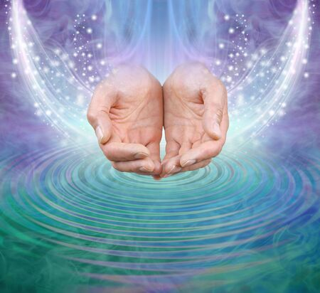 Cause and Effect of Giving and Receiving concept - male cupped hands making waves and receiving sparkling energy