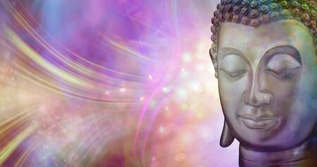 A moment of beautiful inspiration - buddha head against a vibrant multicoloured sparkling glowing ethereal energy formation background with copy space Imagens