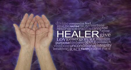 The Humble Hands of a Spiritual Healer - female cupped hands beside a HEALER word tag cloud against a dark purple red energy formation background