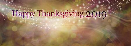 Happy Thanksgiving 2019 background Banner - gold and brown bokeh and sparkles background with the words HAPPY THANKSGIVING 2019 across the top with copy space below Imagens