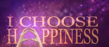 I choose happiness spiritual message banner - female hands making the A of HAPPINESS below the words I CHOOSE against a pink purple bokeh background Stock fotó