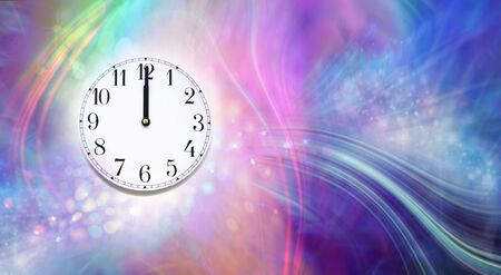 Happy New Year Midnight Clock Face Message Banner - party effect multi coloured fun looking sparkling bokeh background with  a clock face showing midnight on the left side and copy space on right Фото со стока