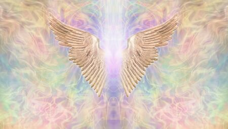 Golden Angel Wings Banner - Wide wispy multicoloured ethereal background with a pair of golden Angel Wings in the center with a shaft of bright light between and  copy space both sides