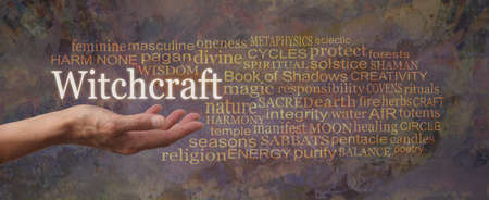 Words associated with Witchcraft Tag Cloud - female hand open palm with the word WITCHCRAFT floating above surrounded by a relevant word cloud on a rustic grunge earthy brown background