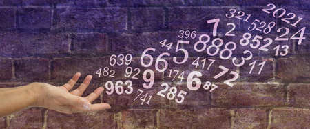 Numerologist concept brick wall banner - female hand sending out random numbers against a purple brown brick wall background