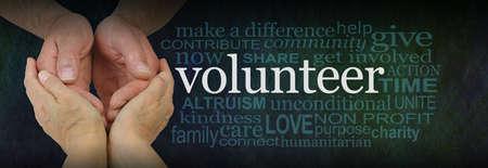 Volunteer Careworker Word Cloud - female hands cupped around male cupped hands next to a VOLUNTEER word cloud on a dark green background Zdjęcie Seryjne - 160002016