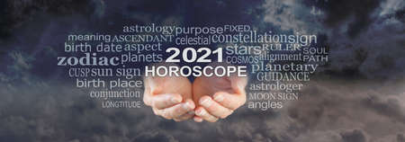 Your 2021 HOROSCOPE is written in the Stars - wide night sky cloudscape dark background with a pair of female hands cupped underneath the words 2021 HOROSCOPE  surrounded by a word cloud