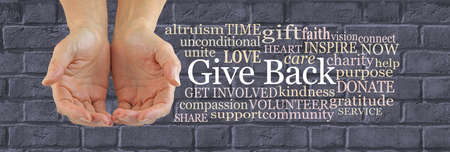 Make a Difference and Give Back Word Cloud - female hands gently cupped beside a GIVE BACK word cloud against a wide grey brick wall background