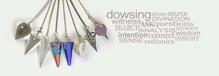 Choose a Crystal Dowsing Pendulum word cloud banner - eight different quartz crystal dowsing pendulums arranged in a neat curve beside  a DOWSING word cloud on off white background Zdjęcie Seryjne