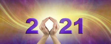 Looking ahead into 2021 - female hands making the 0 of 2021 on a gold and purple swishing  background with plenty of copy space Zdjęcie Seryjne