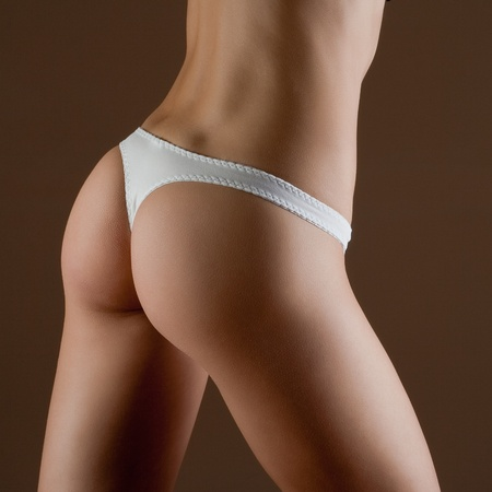 Beauty and perfect woman with ideal fitness body in white panties