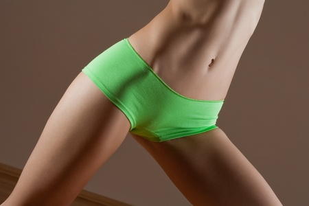 Beauty and perfect woman with ideal fitness body in green panties photo