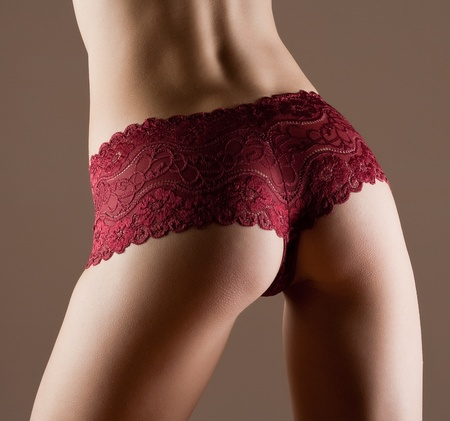 Beauty and perfect woman with ideal fitness body in red panties Stock Photo