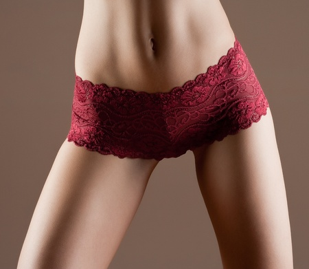 red panties: Beauty and perfect woman with ideal fitness body in red panties Stock Photo