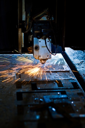 Laser cutting with sparks close up Stock Photo - 13282243