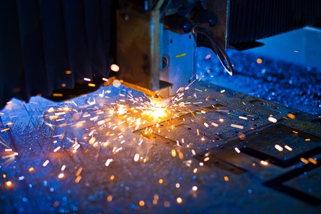 Laser cutting with sparks close up Stock Photo - 13282257