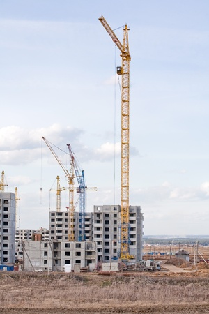 The construction of several large residential apartment buildings in the field photo