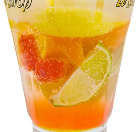 A delicious refreshing cocktail with slices of orange, strawberry, lemon and lime photo