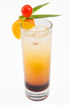 A delicious refreshing cocktail with slices of orange and a cherry on top