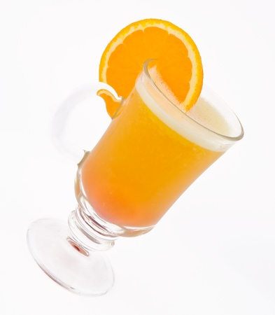A delicious cocktail from orange juice in a glass beaker decorated with a slice of orange photo