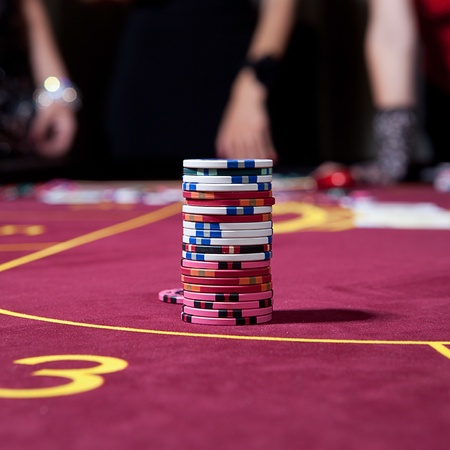tower from chips on the poker table photo