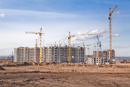 The construction of several large residential apartment buildings in the field
