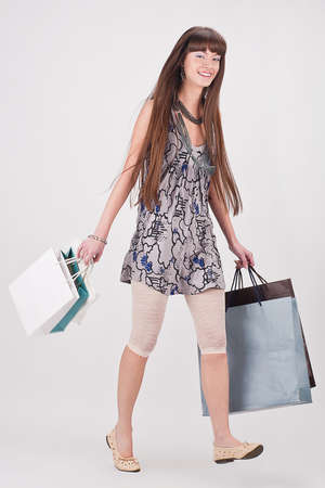 Young attractive girl enjoys a large number of purchases photo