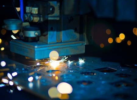 Laser cutting with sparks close up Stock Photo - 13282029