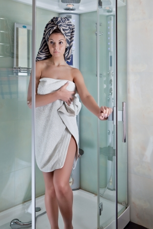 Beautiful smiling girl after a shower in a white towel Stock Photo