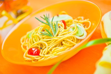 plate of pasta on the table photo