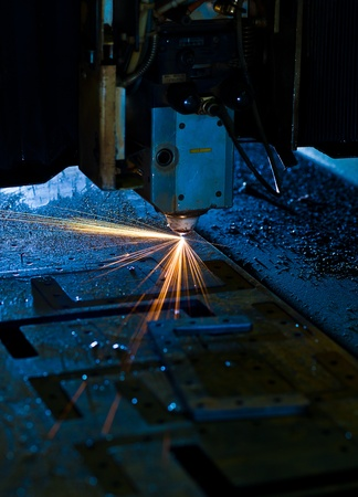 Laser cutting with sparks close up Stock Photo - 13282242