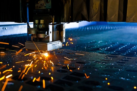 metal sheet: Laser cutting with sparks close up