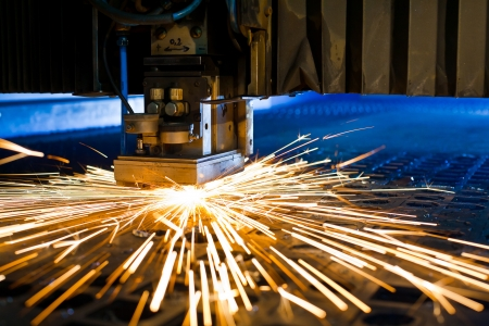 plasmas: Laser cutting with sparks close up