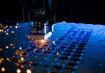 machinery space: Laser cutting with sparks close up