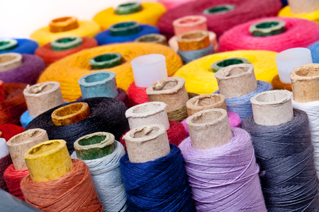 close up of spools of thread of different size, texture and colour photo