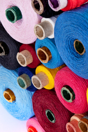close up of spools of thread of different size, texture and colour