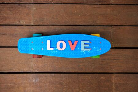 word love made up of colorful wooden letters on the blue penny board. February 14, Valentine photo