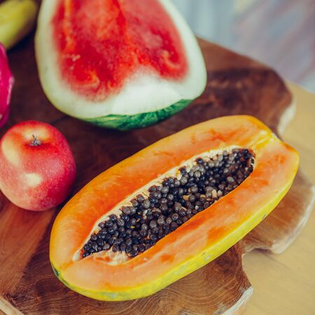 Tasty fruits on a kitchen. Papaya, papaw, pawpaw, Carica, apple, watermelon, dragon fruit. Healthy eating lifestyle concept. Health care and beauty. Healthy breakfast. Fitness food. Proper nutrition.