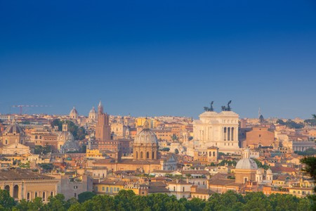 Beautiful view of Rome, Italy. Sunny summer evening. Aerial panoramic cityscape of Rome. Rome skyline with the dome of Saint Agnese Church, the Campidoglio and the Altare della Patria monument. Reklamní fotografie