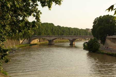 Evening time on the Tiber river, Rome, Italy. Bridge and embankment on the Tiber river, Rome.