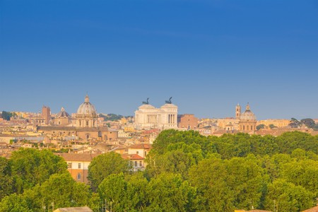 Beautiful view of Rome, Italy. Sunny summer evening. Aerial panoramic cityscape of Rome. Rome skyline with the dome of Saint Agnese Church, the Campidoglio and the Altare della Patria monument. 版權商用圖片