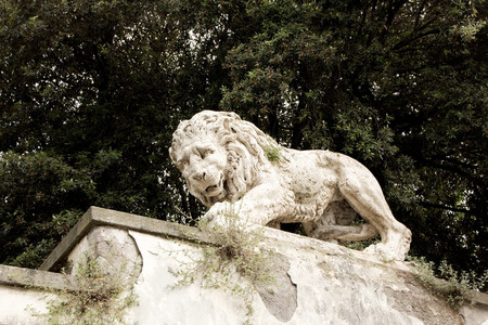 Lion sculpture in Garden of Villa Borghese. Rome, Italy. Decoration and architecture of the garden.