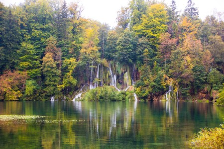Colorful autumn in the national Park Plitvice lakes. Beautiful view on the waterfalls in Plitvice National Park, Croatia. Colorful misty autumn.