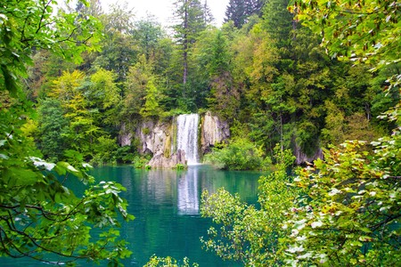 Plitvice lakes national Park, Croatia. View of a beautiful waterfall through the trees.