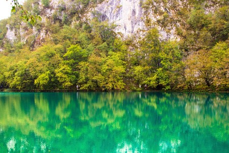 Plitvice lakes national Park, Croatia. Amazing green color of water. Beautiful landscape lake and mountains.
