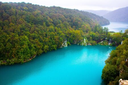 Amazing breathtaking landscape in Plitvice National Park, Croatia. Lakes and waterfalls in forest. Crystal clear azure blue water. Top view of Plitvice Lakes.