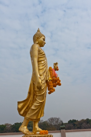 nakhon pathom: Buddha Stand In the garden. Buddhist province Nakhon Pathom Thailand.