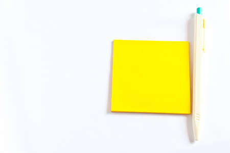 Colored notes papers on white background and pen Stock Photo - 8795881